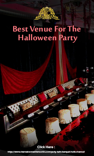 Beautifully arranged party hall in Chennai for the halloween party in red and white color decor.