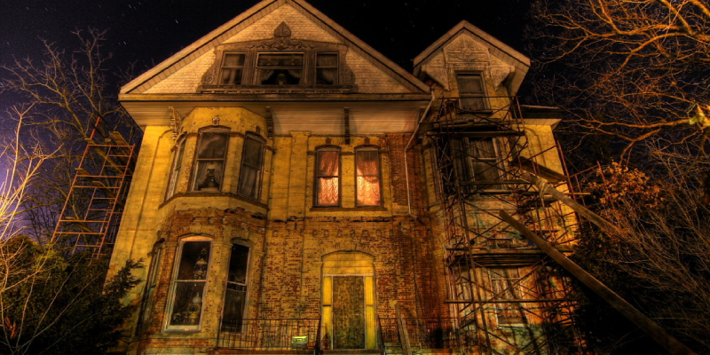 A Scariest Haunted House In Night Background.